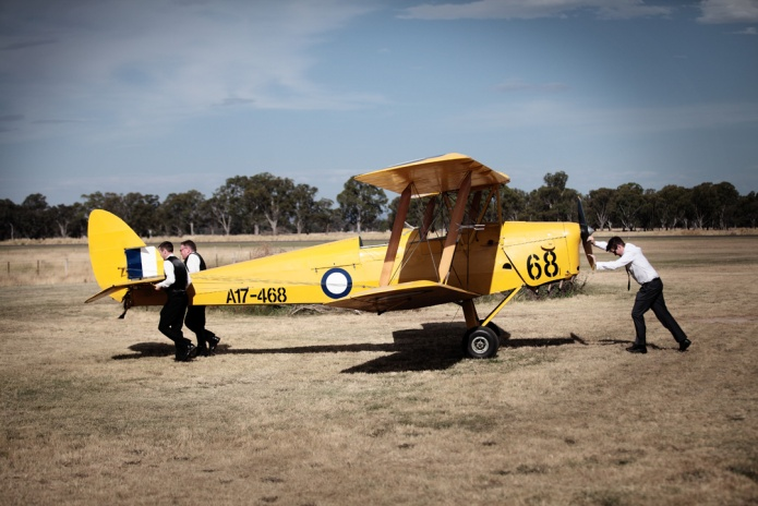 The boys pulling a very lightweight Tiger Moth.