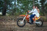 Bride and groom on motorbike